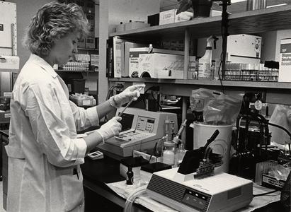 Joan Boettcher performing HIV assay