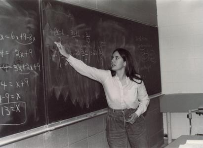 Mathematics professor Collen Vachuska at classroom blackboard