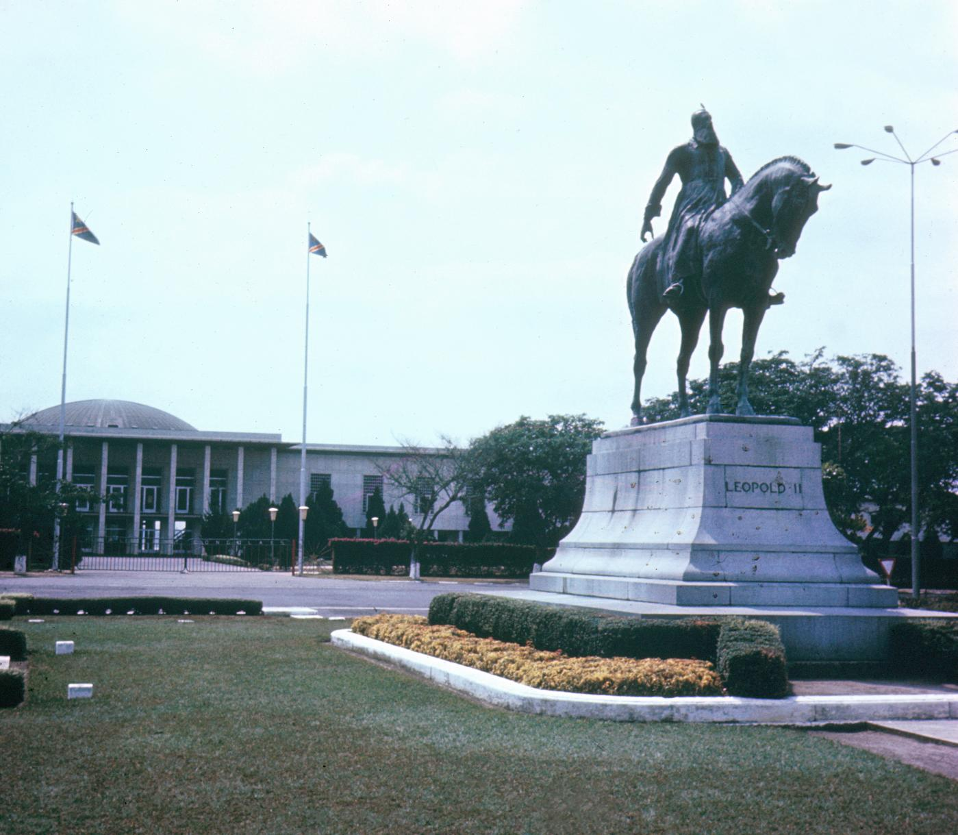 Statue of King Leopold II of Belgium with Parliament Building in Background