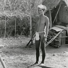 Nyaheun man wears traditional clothing in the village of Lassasine in Attapu Province