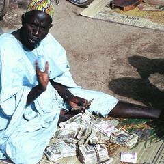 Hausa Banker and Money Changer in Maiduguri Market