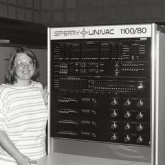 Rose Smith standing next to the UNIVAC 1100/80