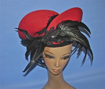 Red felt hat with black feathers