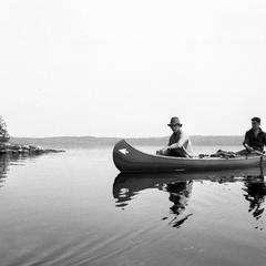 Bergere Kenney and unidentified person canoeing at Quetico