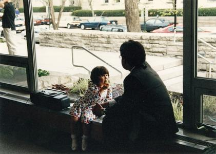 Man and girl at 1995 graduation reception