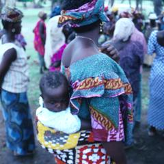 Baby on Mother's Back at Meeting to Learn New Technology for Rice Farming
