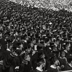 Crowd in caps and gowns