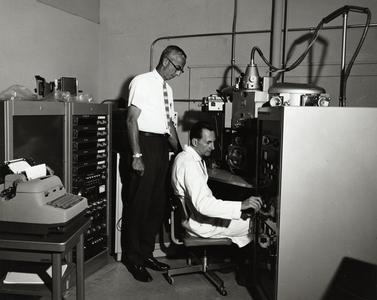 Eugene Cameron with electron microscope