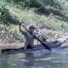 Boy paddling boat