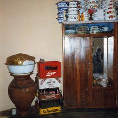 Cabinet with crockery and bottles