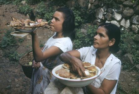 Women selling chicken and meat pies along railroad