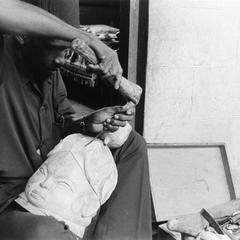 Mask Carver Making Hair on Bundu Mask