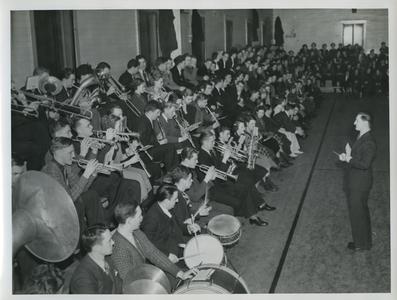 Stout Band playing pep music at a basketball game