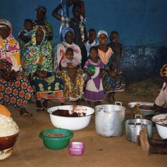 Group seated in shea butter workshop