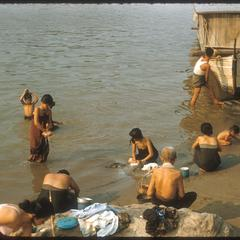 Bathing, washing, playing in river