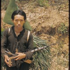 Hmong (Meo) with a load of grass