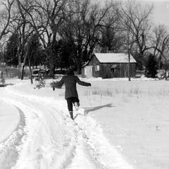 Ruth running up shack driveway