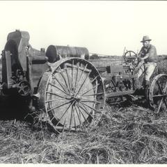 Man on a rice harvesting machine, Tarlac, 1927