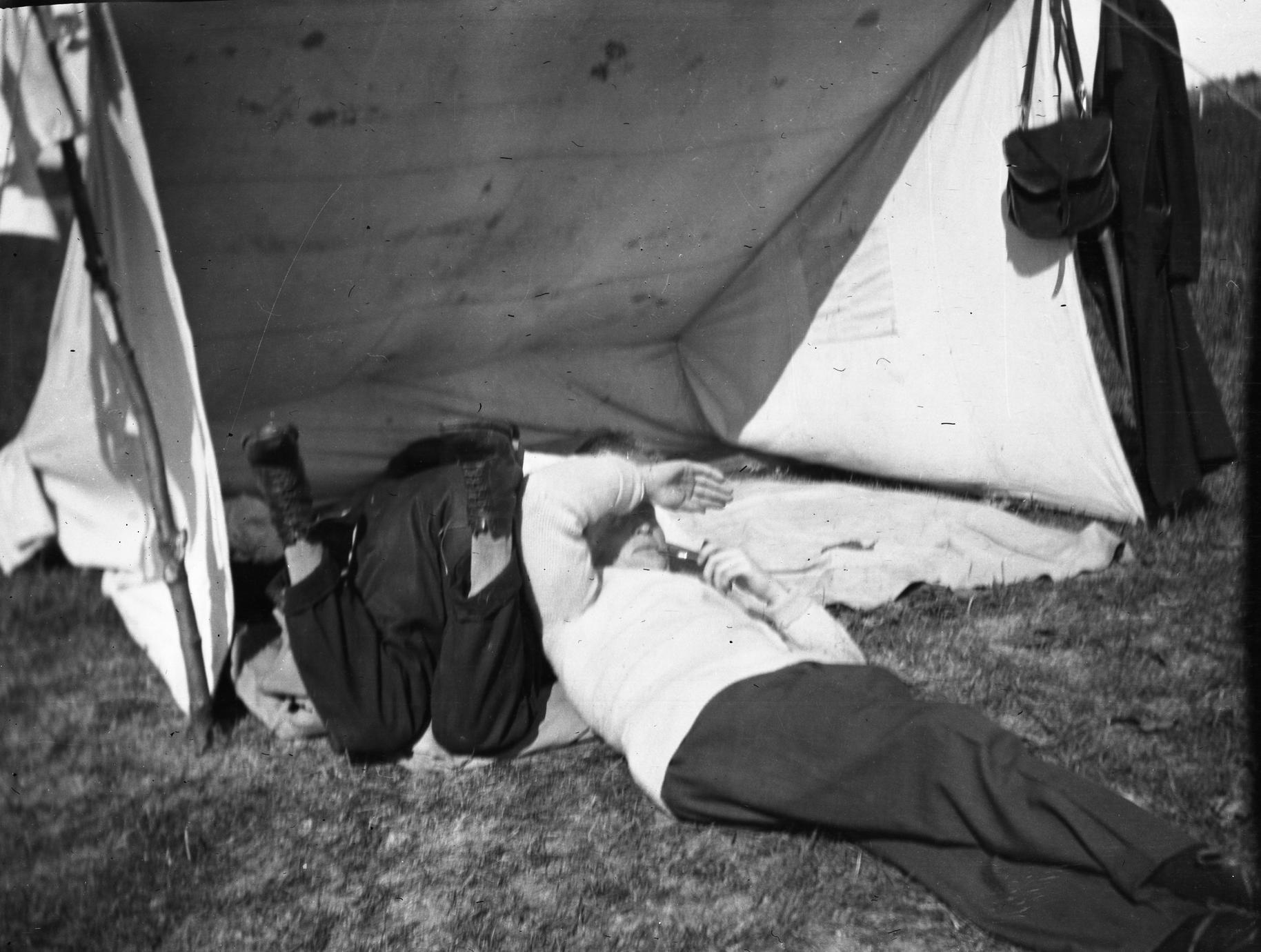 Men reclining in tent