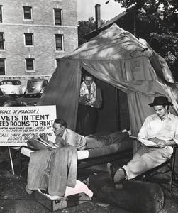 Vets read and shave in makeshift tent