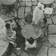 Waiter serving students on Terrace