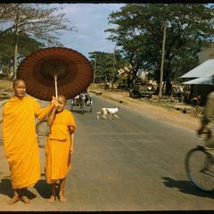 Monk and novice on street