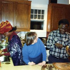 Nike, Folarin, and Trager making dinner at Trager's home