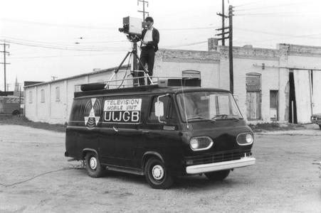 Student cameraman on top of UW-Green Bay Mobile Television Unit