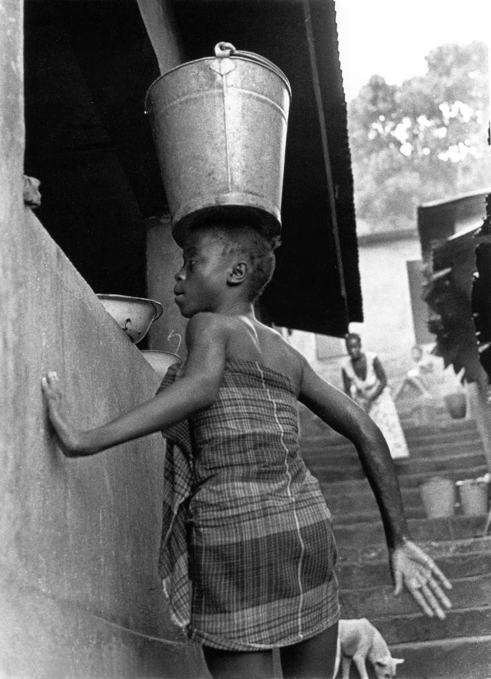 Girl Bringing Water to Her House