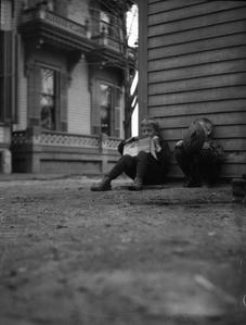 Boys sitting outside Burlington home