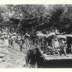 Hauling sacks to river, ca. 1920-1930
