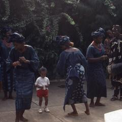 Drummers, women, and child dancing