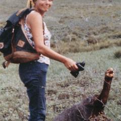 "Lynn R. Reeder (Field Assitant) with a giant tortoise (Geochelone elephantopus ephippium) ""Onan"""