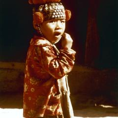 Yao (Iu Mien) child with needlework cap in Houa Khong Province