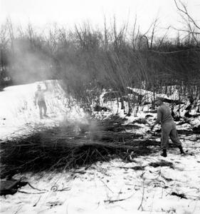 Aldo and another burning brush piles in winter