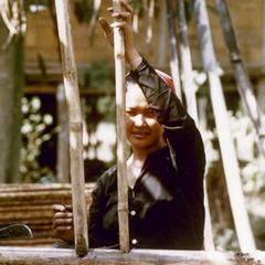 A Khmu' woman repairs a fence around her garden in Houa Khong Province