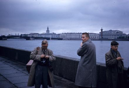 Men standing along the Neva River