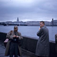 Men standing along the Neva River