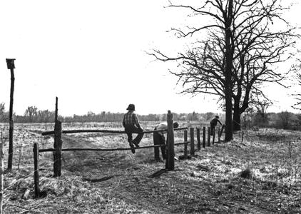 Estella Jr., Aldo Leopold, and Estella working on fence along Levee Road