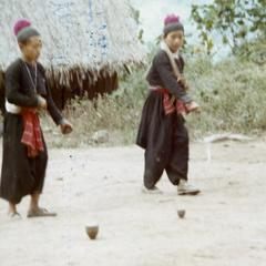Blue Hmong (Hmong Njua) children playing games in the village in northern Thailand