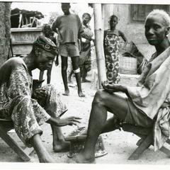 Man and woman playing ayo