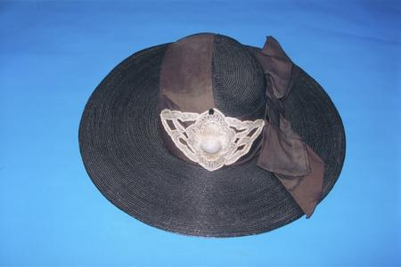 Wide-brimmed black straw hat with bow