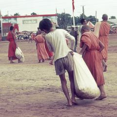 Carrying rice for monks