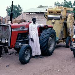 Tractor and Thresher Owned by a Village