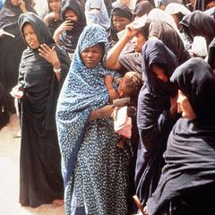 Women with Vaccination Cards Waiting to See Doctors