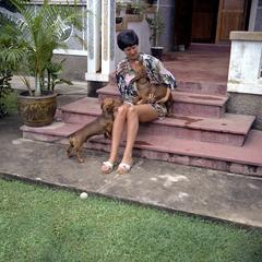Terry Wofford and dachshunds on porch steps