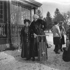 Women posing with sled