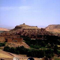 Roadside Pottery with View of  Fortified Town of A∩t Benhaddou in the High Atlas