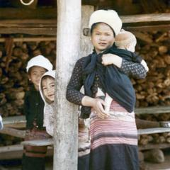Mother with child in the Lu village of Ta Fa in Houa Khong Province