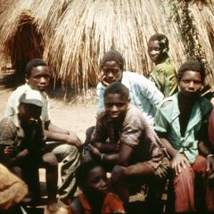 Young Men Listening to Oral Narrative in Fishing Village